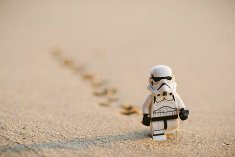 Storm trooper lego walking in the sand