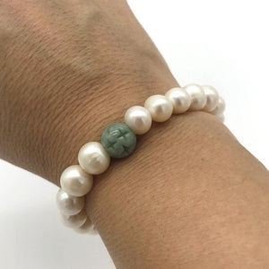 Shop uncommon gifts like our freshwater pearl bracelet with jade bead