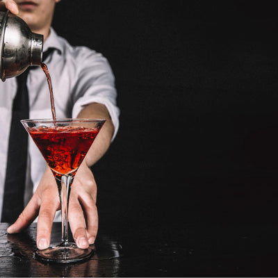 pouring a shaken cocktail