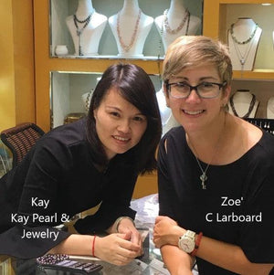 Zoe and Kay choosing jewelry for our C Larboard Gift Shop!
