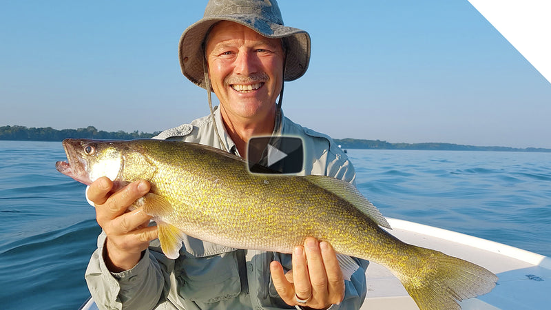 Deep water jigging for walleye along a break