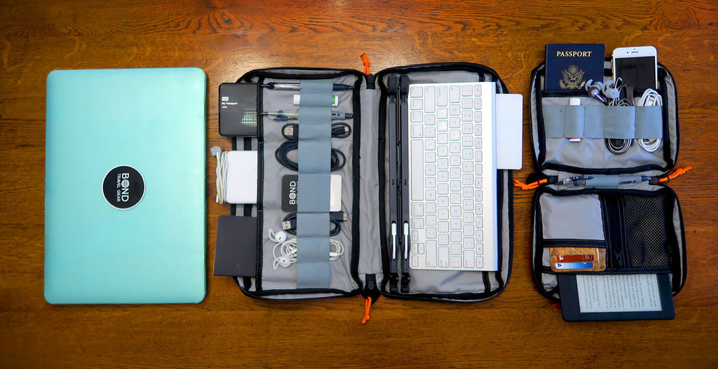 My electronics: ROAM pouch, ESCAPADE pouch, laptop, keyboard, laptop stand, external hard drive
