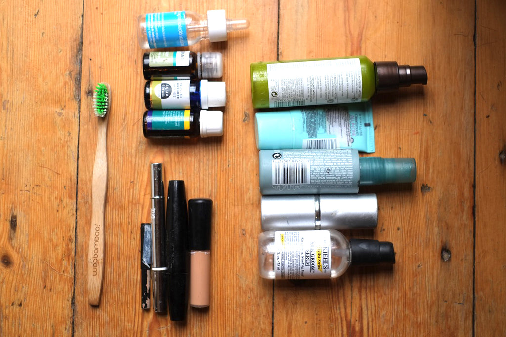 My toiletries: toothbrush, tooth powder, minimal makeup, essential oils, travel towel