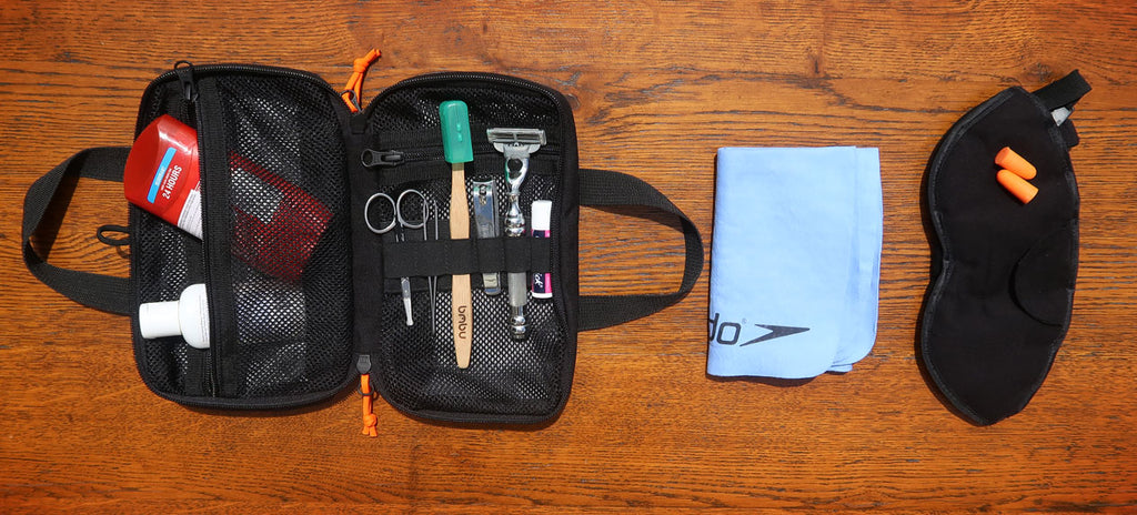My toiletries: DASH dopp kit, toothbrush, tooth powder, razer, nail clippers
