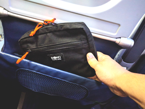 ESCAPADE Gear Pouch is perfect to contain your long flight survival kit. Easily slips into the seat pocket ahead of you.