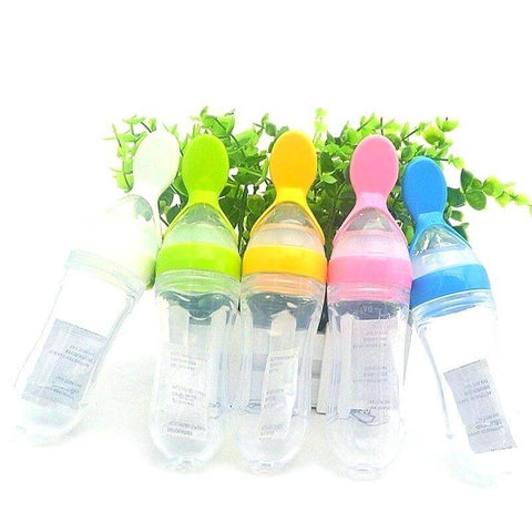 baby feeding bottles with spoon