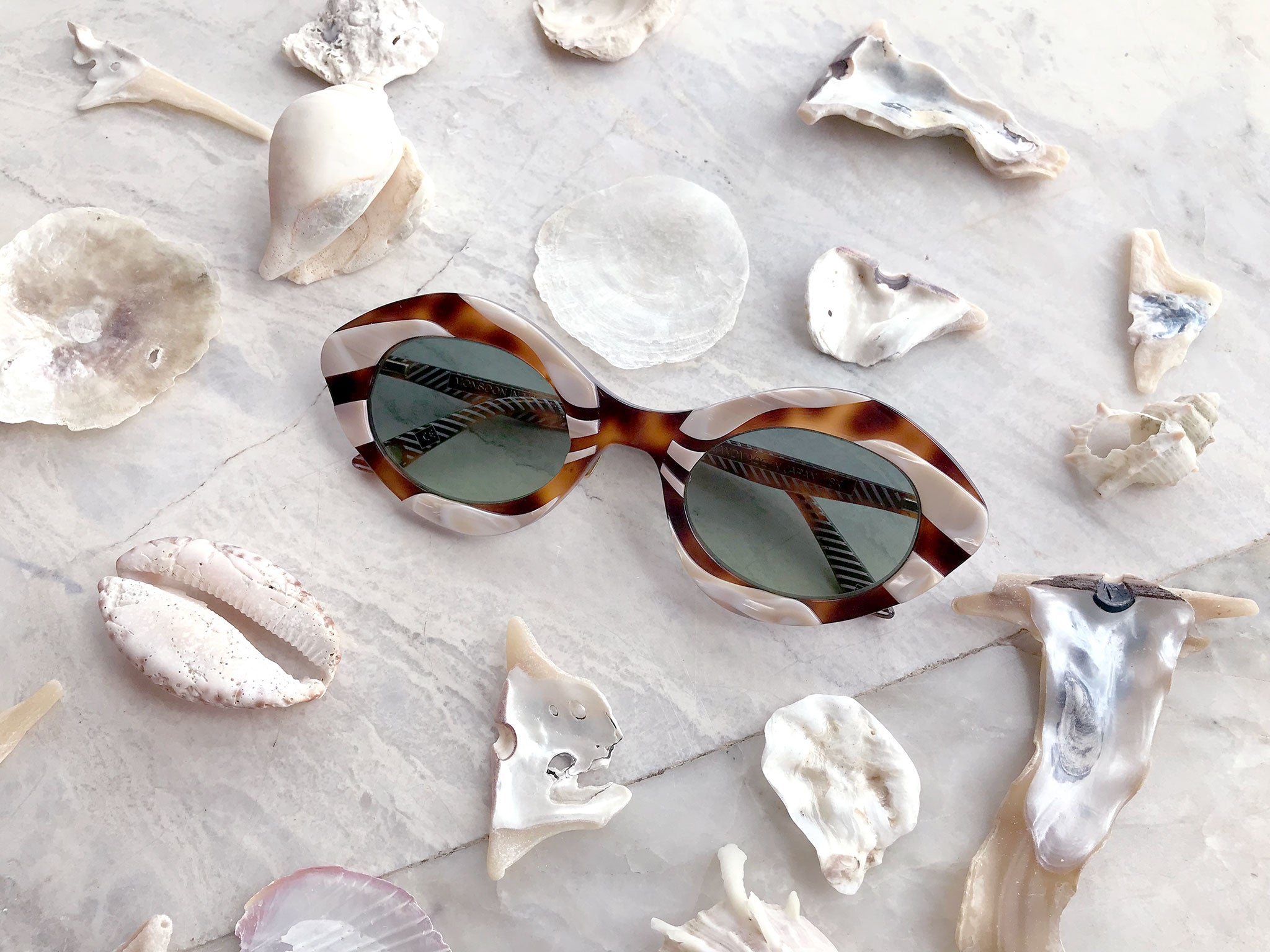 Oval Sunglasses with mother of pearl acetate. Made in Japan with 18K gold details