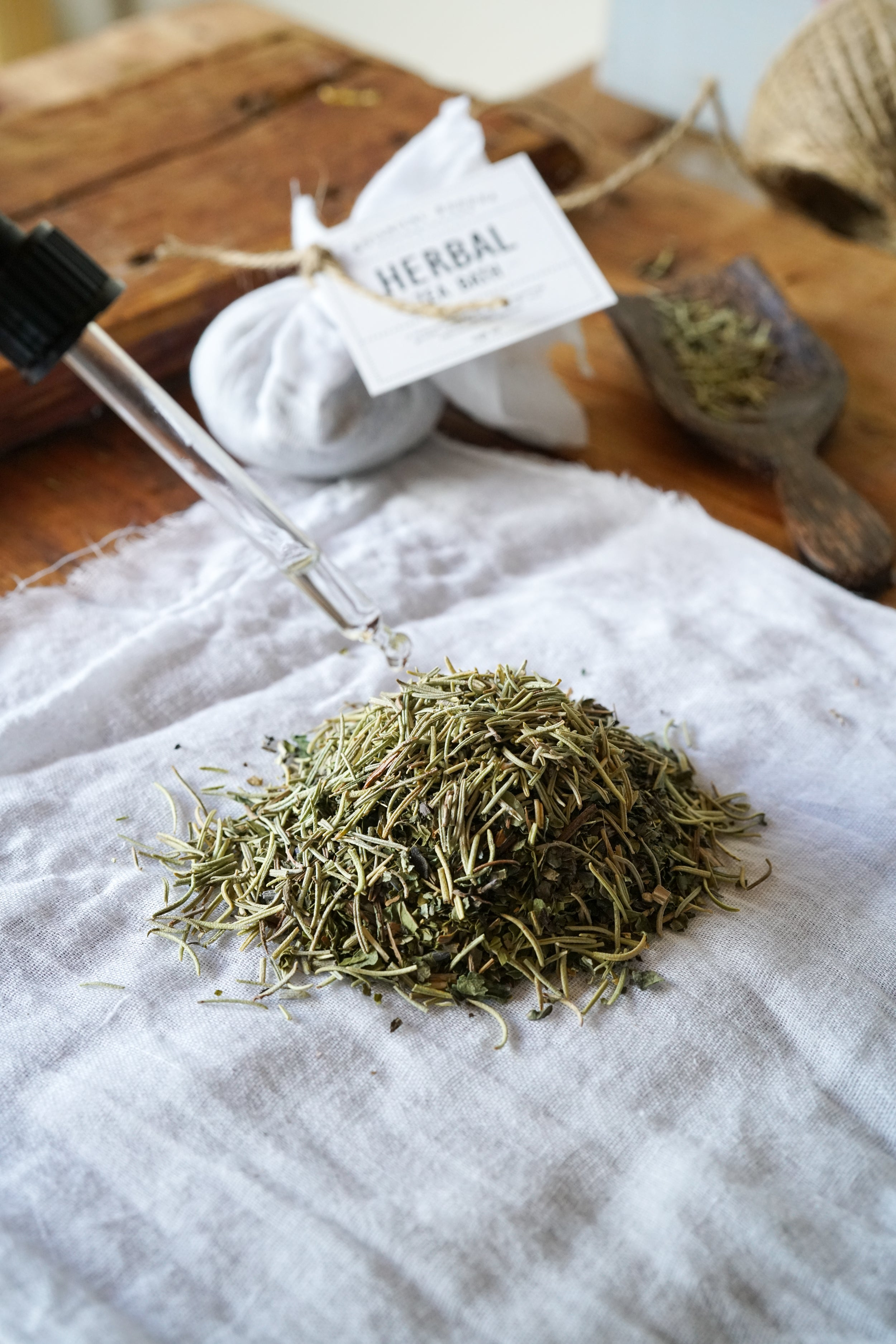 Adding essential oils to the herbs