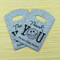 9*15CM 150pcs/lot Gray Smile Face small plastic bag jewelry gift packaging bag cute plastic gift bags shopping bags with handle - onlinejewelleryshopaus