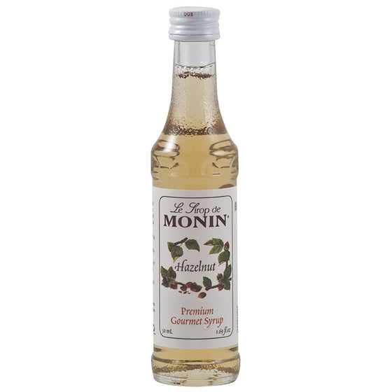 mini bottles of Monin hazelnut syrup