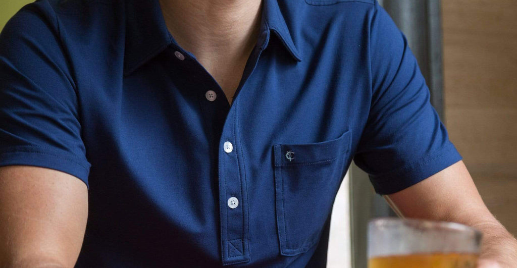 Man wearing Criquet Top Shelf Polo in Navy Blue.