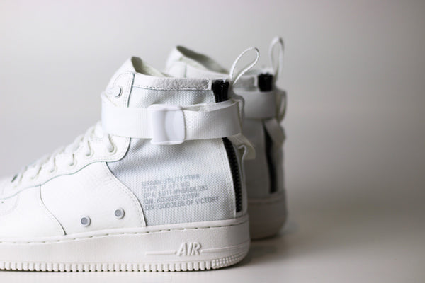 "Nike SF AF1  Mid ""Triple Ivory"" Available at ROOTED After Dark"