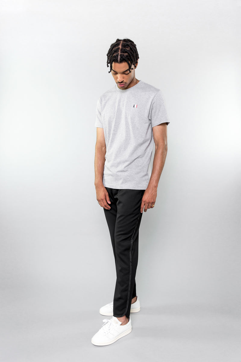 AMI t-shirt in heather grey on model with Saturdays pants and adidas shoes