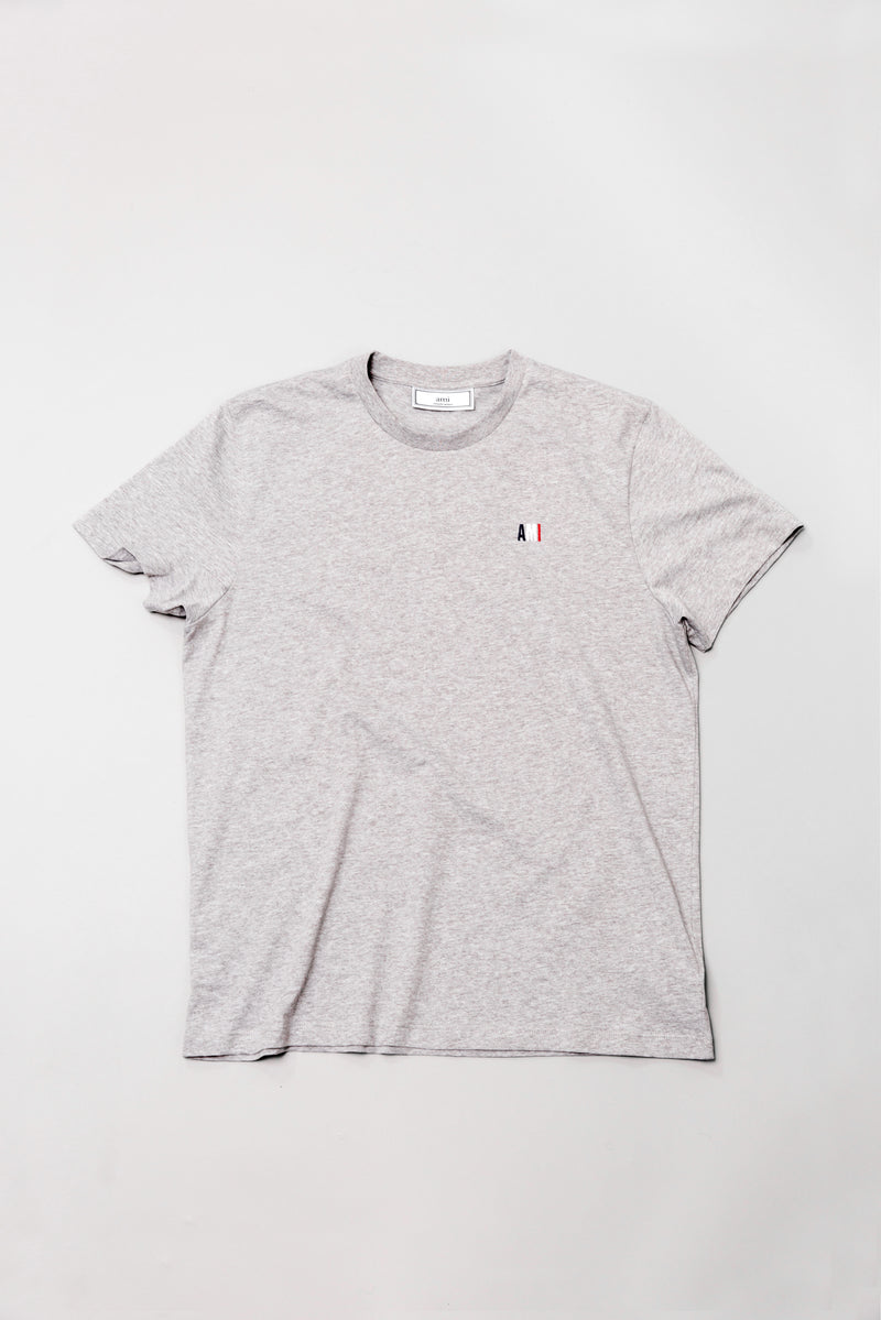 AMI t-shirt in heather grey laying on grey backdrop