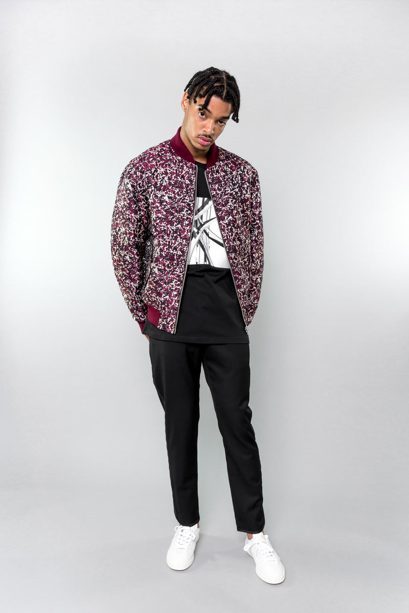 Floral side of Public School Beve Reversible Bomber on model
