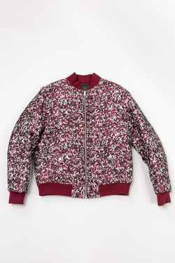 Floral side of Public School Beve Reversible Bomber laying on grey backdrop