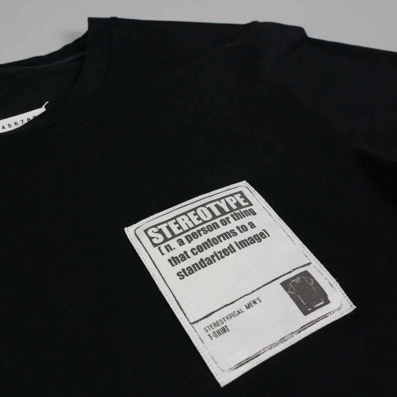 Patch detail of black Maison Margiela 'Stereotype' T-Shirt at ROOTED