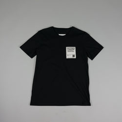Front of black Maison Margiela 'Stereotype' T-Shirt at ROOTED