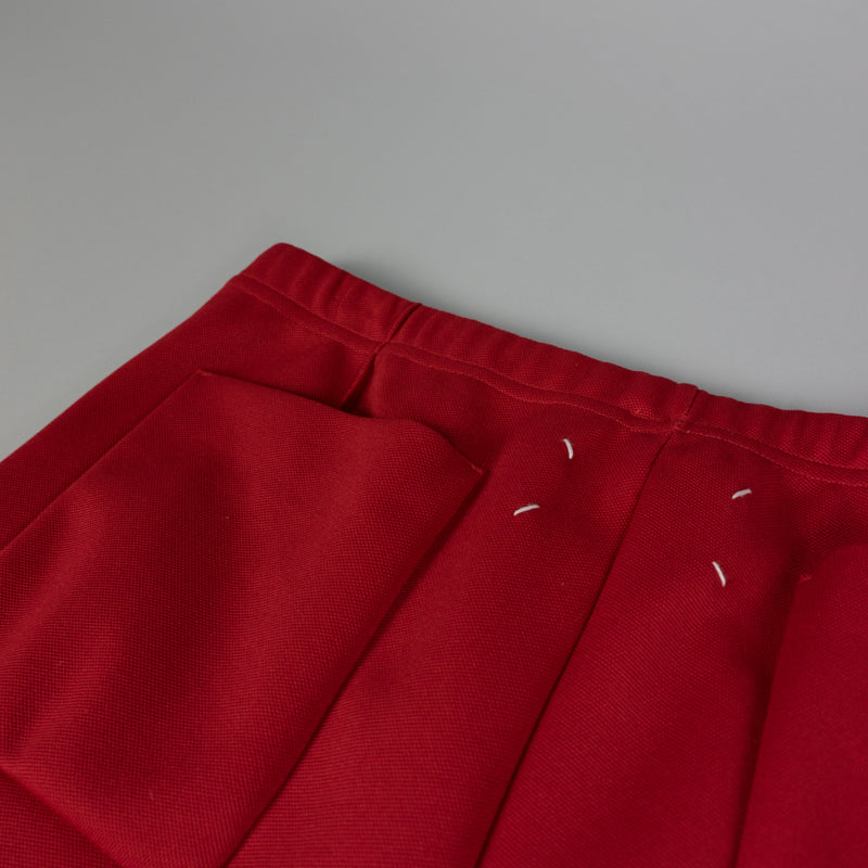 Back pocket detail of Maison Margiela Loose Fit Track Pant in Red