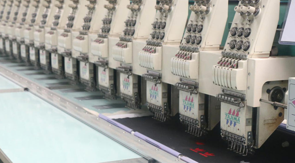 A 20-head Tajima embroidery machine can produce up to 20 garments at a time!
