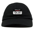 on the front of the hello my name is papi black name tag dad hat, it says hello my name is papi on a name tag style logo