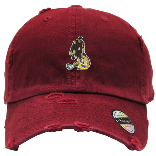 on the front of the Allen Iverson maroon distressed vintage dad hat there is an image of Allen Iverson stepping over Tyronn Lue embriodered
