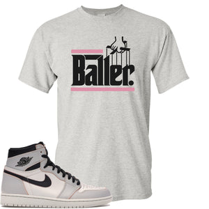 This white and black t-shirt matches great with your Nike SB x Air Jordan 1 Retro High OG Light Bone shoes