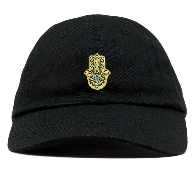 the hamsa amulet dad hat is gold and baby blue