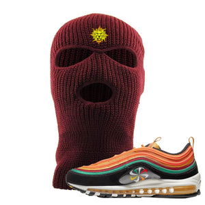 Embroidered on the front of the maroon Air Max 97 Sunburst sneaker matching maroon ski mask is the Vintage Lion Head logo