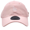 embroidered on the front of the premium black label pink with rose gold los angeles dodgers dad hat is the dodgers logo embroidered in white