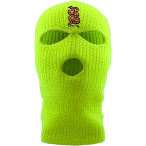 Embroidered on the forehead of the safety yellow coiled snake ski mask is the snake logo in red, white, and black |Jackboys ski mask