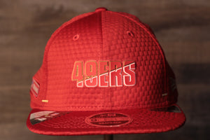49ers 2020 Training Camp Snapback Hat | San Francisco 2020 On-Field Red Training Camp Snap Cap the front of this 49ers hat has the niners name on it