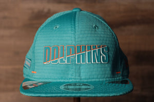 Dolphins 2020 Training Camp Snapback Hat | Miami Dolphins 2020 On-Field Teal Training Camp Snap Cap the front of this cap has the dolphins name on it