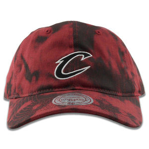Embroidered on the front of the Cleveland Cavaliers maroon and black acid wash dad hat is the Cavaliers logo embroidered in black and white
