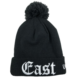 on one side of the Philadelphia 76ers Eastern Conference black knit beanie is the word East in white old english letters