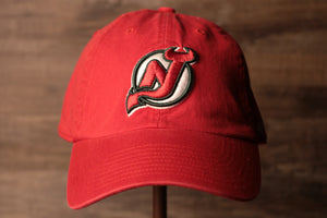 Devils Dad Hat | New Jersey Devils Red Baseball Cap the front of this devils cap has the devils logo with a dark green outline