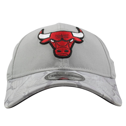 hot sale online 56e05 31168 Embroidered on the front of the Chicago Bulls gray shadow camo brim dad hat  is the