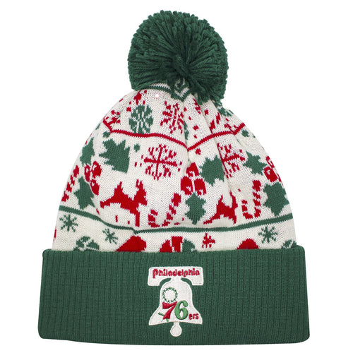 on the front of the philadelphia 76ers ugly sweater pattern winter beanie is the philadelphia 76ers logo embroidered in tan, red, and green.