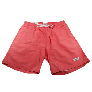 The coral swim shorts are a coral color with side pockets