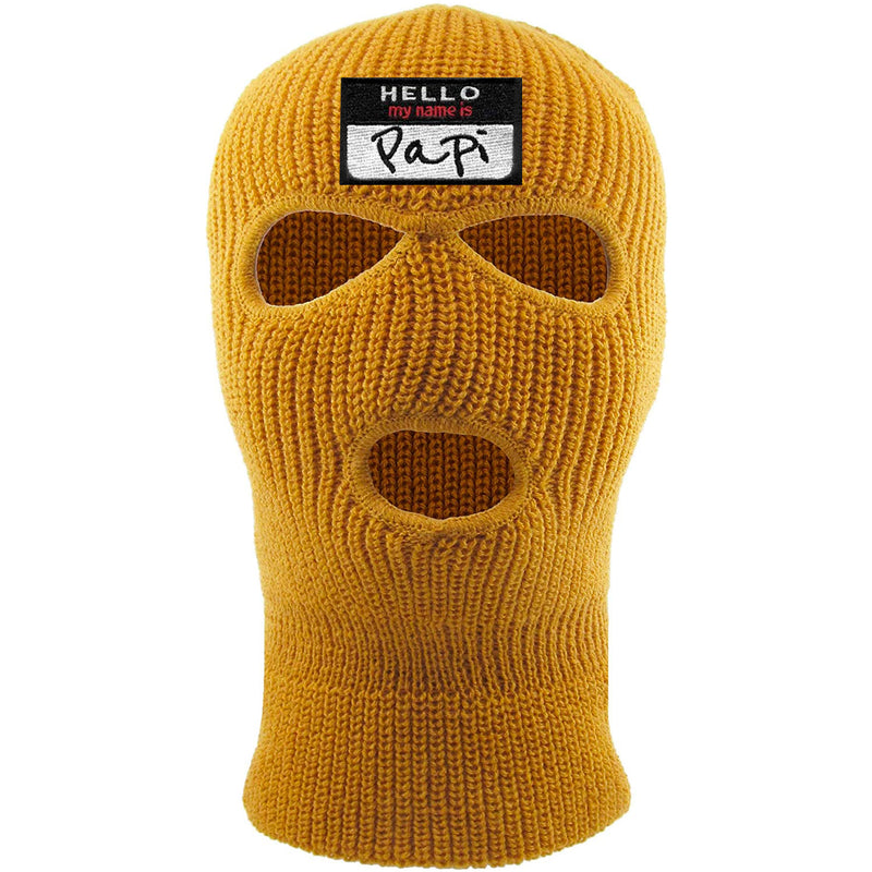 Embroidered on the front of the timberland ski mask is the hello my name is papi logo embroidered in black, white, and red