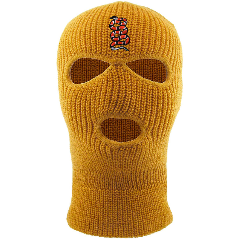 Embroidered on the forehead of the timberland coiled snake ski mask is the snake logo in red, white, and black