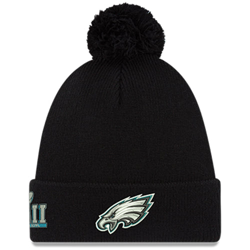 on the front of the philadelphia eagles winter pom beanie is the philadelphia eagles logo embroidered in white, black, silver and eagles green