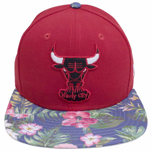 the red chicago bulls floral brim snapback hat has a red crown with a chicago bulls logo on the front in red black and white