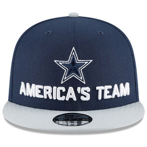 Embroidered on the front of 2018 Dallas Cowboys Draft snapback hat is the Dallas Cowboys logo embroidered in navy blue and white with the words America's Team embroidered in white below the star