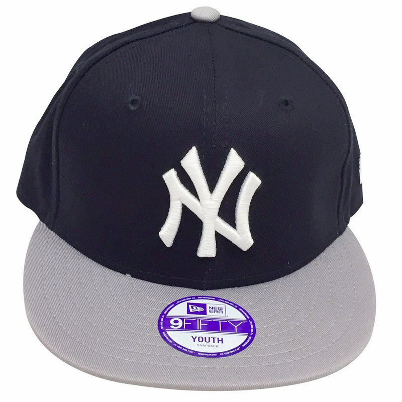 the kid's sized new york yankees snapback hat has a navy crown and a gray brim, on the front of the yankees kid's sized snapback hat the new york yankees logo is embroidered in solid white