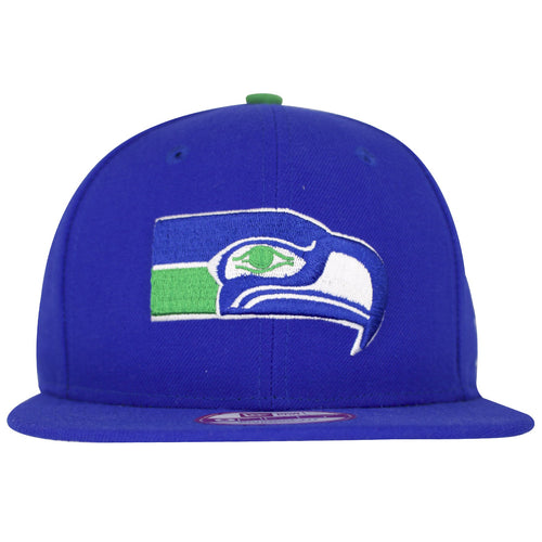 The Retro Seattle Seahawks logo is shown large on the front of this Royal Blue structured snapback hat. The Seattle Seahawk logo is outlined in white threading.