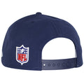 on the back of the new england patriots sideline snapback hat is the nfl logo embroidered in red, blue, and white next to a navy blue adjustable snap