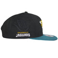 On towards the right side of this Jacksonville Jaguars Sideline snapback is the Jacksonville Jaguars wordmark embroidered in white threading.