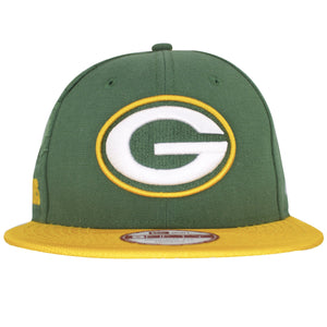on the front of the green bay packers sideline snapback hat is the green bay packers logo embroidered in white, green, and yellow