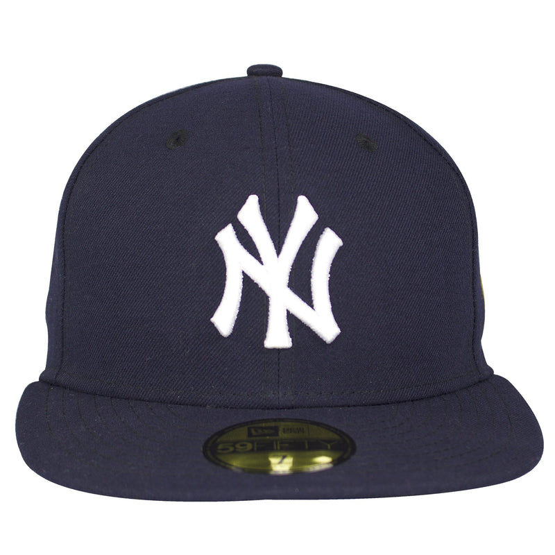 on the front of the new york yankees usa flag patch fitted cap is the new york yankees logo embroidered in white